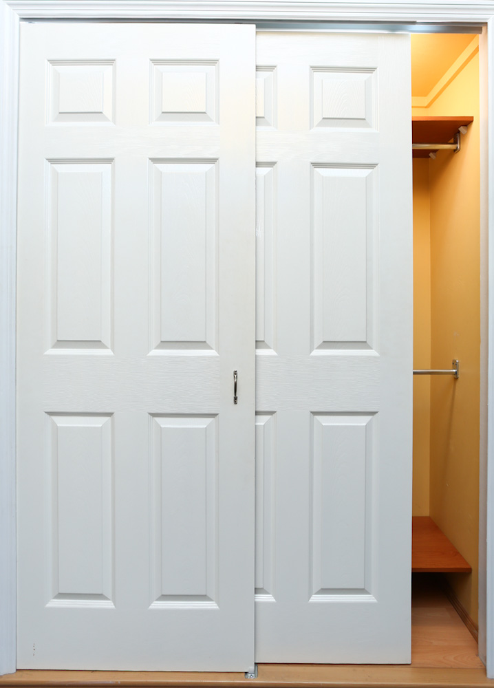 Sliding wood closet doors news sliding mirror closet for Wood bypass closet doors